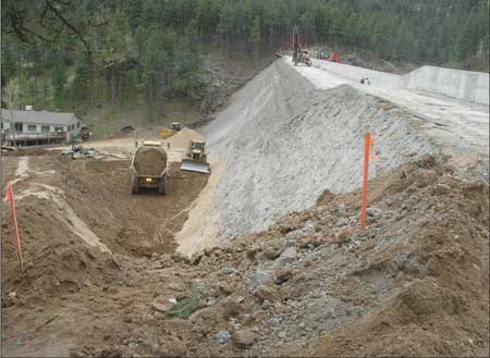 The downstream face of Pine Brook Dam in Colorado was made of unformed concrete that was covered with soil and vegetation. The dam has a conventional concrete upstream face.