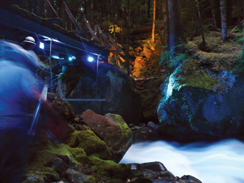 Workers install LED lighting at Ladder Creek Falls as part of Seattle City Light's efforts to restore a light show near its Skagit hydroelectric project. The light show entertained visitors from 1930 to 2004 before being destroyed by a severe storm. It was restored and put back in service in October 2011.