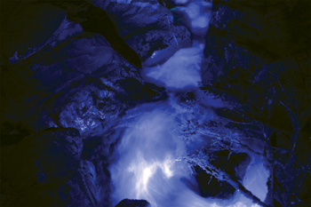 This view shows a downstream view of a lit-up Ladder Creek Falls. Energy-efficient LED lights helped bring the light show back from a seven-year hiatus in October 2011.