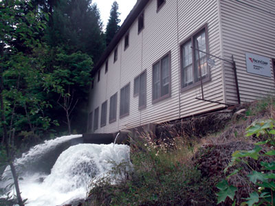 The original wooden structure of the powerhouse at Prospect No. 1, constructed in 1912, still stands on the banks of the Rogue River.
