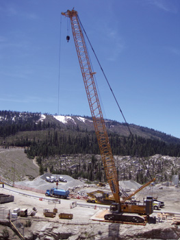 Use of the crane shown above diminished damage to the surrounding area by performing the job of multiple cranes from a solitary position at the site.