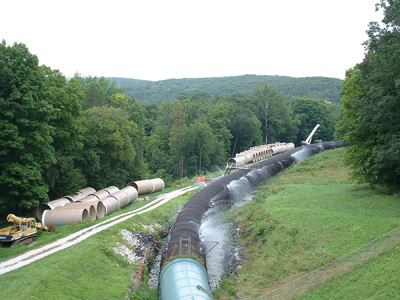 The existing wood penstock supplying water to the 29-MW Rocky River pumped-storage plant had outlived its useful life, as can be seen by the water leakage into the drainage ditches that run parallel to the pipeline.