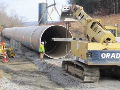 A new 10-foot-diameter fiberglass pipe was installed at the 29-MW Rocky River pumped-storage hydro plant to replace the existing 15-foot diameter wooodstave penstock.
