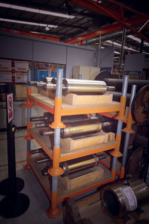 A rack of test rig shafts of different metal grades used for in-house testing.