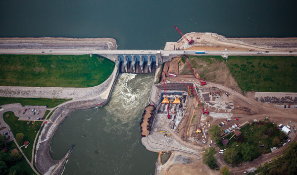 This aerial photo provides an overview of the work under way to add a two-unit, 36.4-MW powerhouse at the existing Red Rock Dam in Iowa. (photo courtesy MRES)