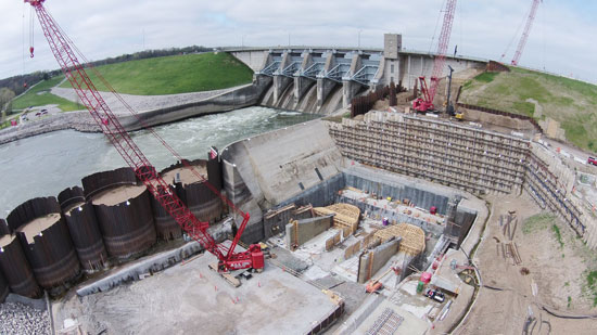 A downstream cellular cofferdam was installed to serve as a water barrier between the river and powerhouse excavation/construction.