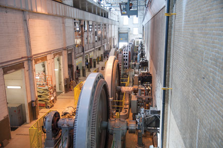 A current-day view of inside the powerhouse shows several of the original 15 horizontal-shaft Francis turbines, some of which are still in use today.