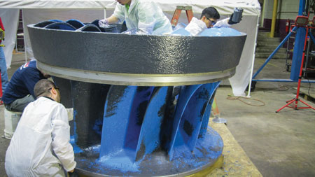 HCMS employees apply a protective Henkel Loctite epoxy coating to the Unit 2 runner following the completion of cavitation repairs.