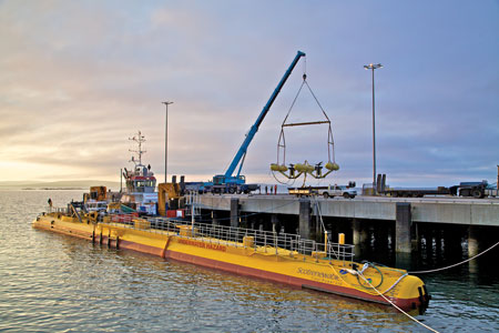 Prior to being deployed, the Scotrenewables SR2000, foreground, and SME PLATO devices are pictured at Hatston Pier in Orkney in June 2016. (Photo: Colin Keldie, courtesy of EMEC)