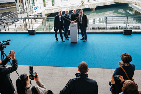 Voith officials start up the Alte Bleiche project at its factory in Heidenheim, Germany.