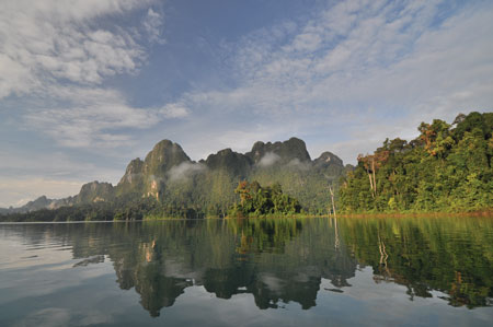 The reservoir created by Thailand's Rajjaprabha Dam has become a popular tourist destination due to its natural beauty.