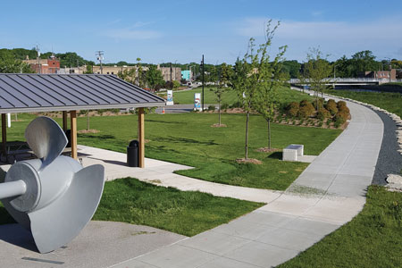 The photo shows the completed park with the old Kaplan turbine.