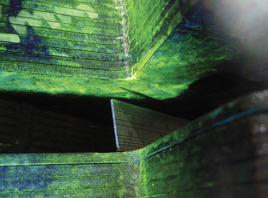 The first indications of cracking were revealed via wet fluorescent magnetic particle testing of the dovetails.