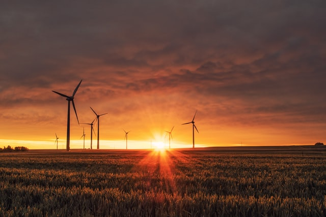 Wind Turbine with Sunset and Field